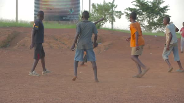 African children play soccer on a dirt field. Royalty-free stock video