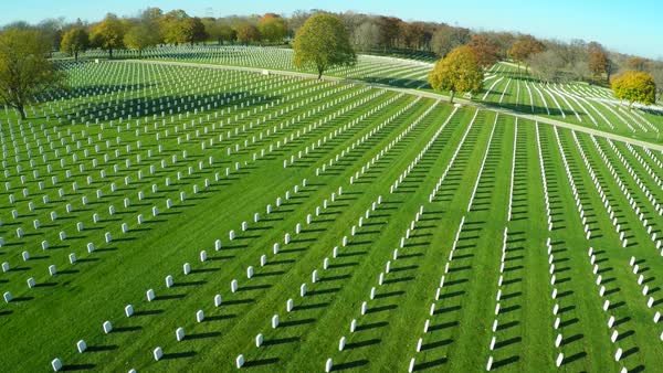 An aerial over a vast cemetery of headstones honors America's veterans. Royalty-free stock video