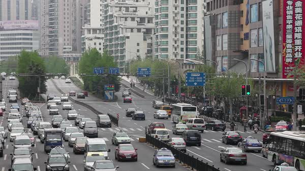Traffic crowds the streets of modern Shanghai,China. Royalty-free stock video