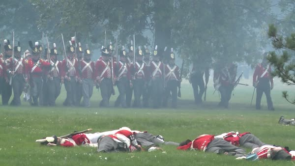 The dead lie on the battlefield in this television style reenactment of the War of 1812. Royalty-free stock video