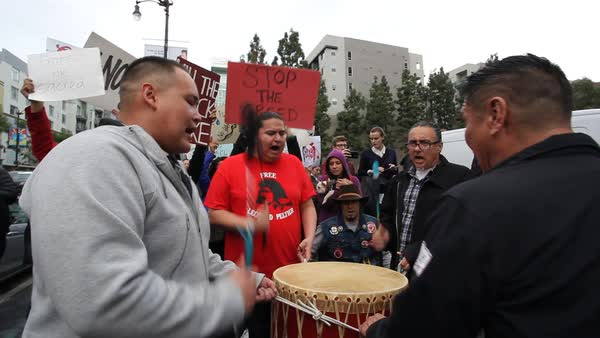 Native Americans pound drums in Hollywood marching and chanting against the Dakota access pipeline. Royalty-free stock video
