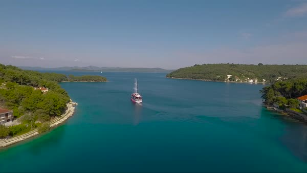 Aerial behind a sailboat and small village in Croatia. Royalty-free stock video