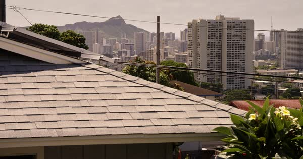 Urban Honolulu Hawaii with suburban rooftops foreground. Royalty-free stock video