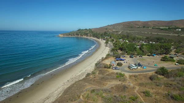 A beautiful rising aerial shot along the California coastline at Refugio State Beach near Santa Barbara. Royalty-free stock video