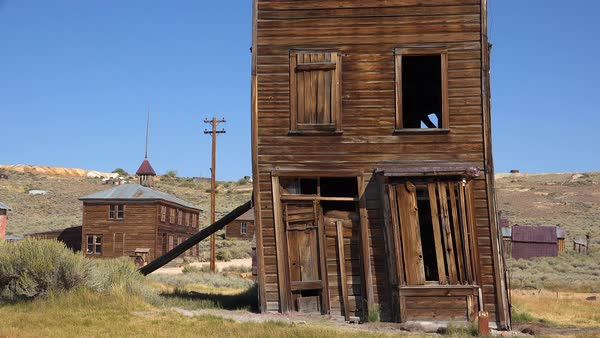 An old building is propped up by a post in the ghost town of Bodie, California. Royalty-free stock video