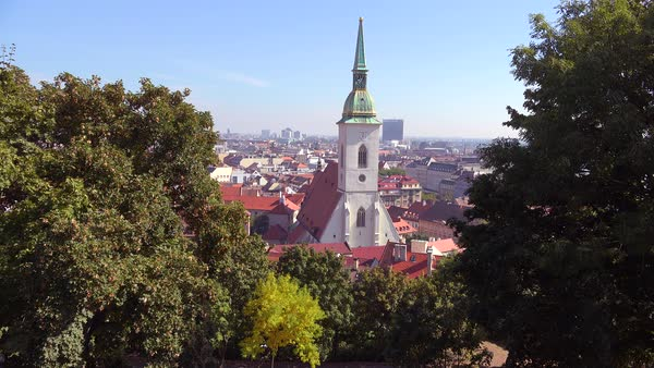Beautiful establishing shot of downtown Bratislava, Slovakia with church foreground. Royalty-free stock video