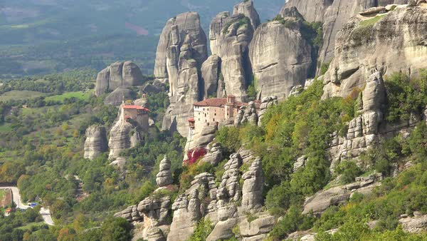 A monastery in Meteora, Greece overlooks a valley below. Royalty-free stock video