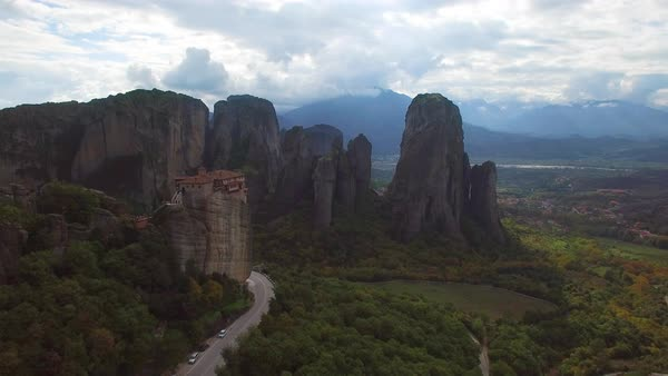 Beautiful aerial in golden light over the rock formations of Meteora, Greece. Royalty-free stock video