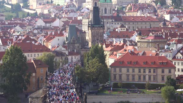 Beautiful day establishing shot crowds moving into the old city in Prague, Czech Republic. Royalty-free stock video
