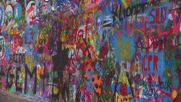 Graffiti art decorates the John Lennon Wall of free speech in Prague, Czech Republic. Royalty-free stock video