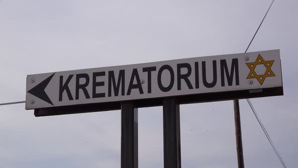 A sign indicates direction to the crematorium at the Terezin Nazi concentration camp in Czech Republic. Royalty-free stock video