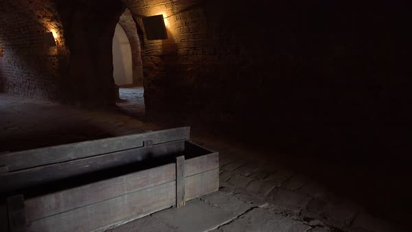 Coffins sit in the darkened crematorium at the Terezin Nazi concentration camp in Czech Republic. Royalty-free stock video