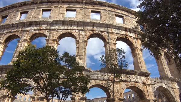 Panning view looking up at the remarkable Roman amphitheater in Pula, Croatia. Royalty-free stock video