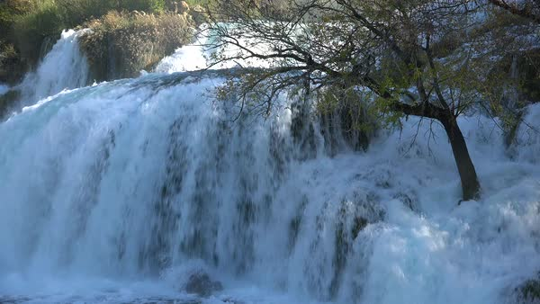 Beautiful raging waterfalls flow through the mountains of Croatia. Royalty-free stock video
