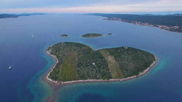 A beautiful aerial over a heart shaped island in the Adriatic sea off Croatia. Royalty-free stock video