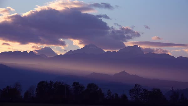 Beautiful rays of light over a mountain range at sunset. Royalty-free stock video