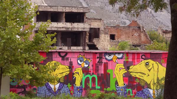 Ruined buildings have art from the war in downtown Mostar, Bosnia Herzegovina.  Royalty-free stock video