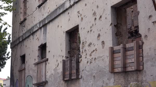 Ruined buildings from the war in downtown Mostar, Bosnia Herzegovina.  Royalty-free stock video