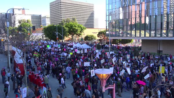 Hundreds of thousands march to protest the presidency of Donald Trump in downtown Los Angeles, California. Royalty-free stock video