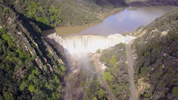 Aerial shot over a dam in full flood stage near Ojai California Royalty-free stock video