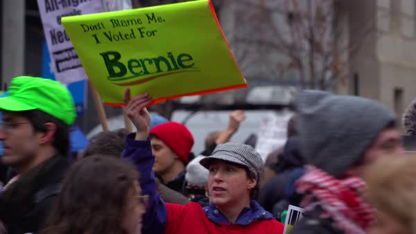 A person holds up a sign saying dont blame me I voted for Bernie Sanders at an anti-Trump rally in Washington DC. Royalty-free stock video