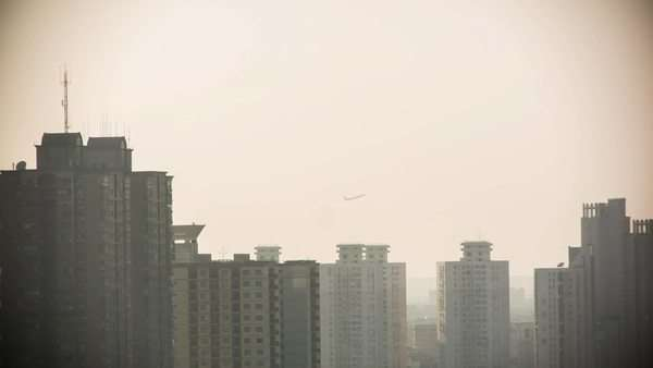 Airplane flying behind Shanghai's downtown district Royalty-free stock video