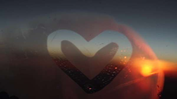 Handheld close-up of a heart on an airplane window Royalty-free stock video