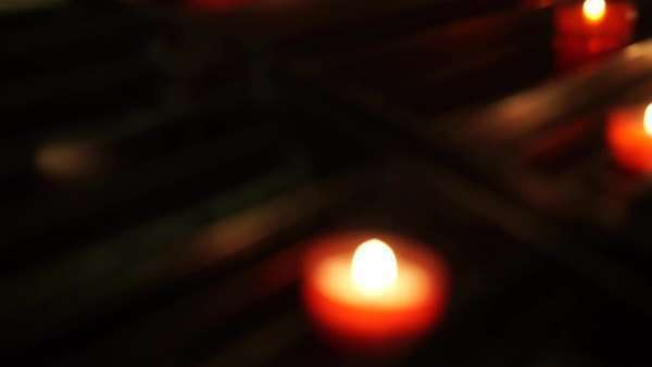 Handheld shot of candles burning in a church Royalty-free stock video