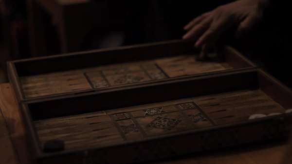 Handheld shot showing a backgammon board and the hands of the two opponent players Royalty-free stock video