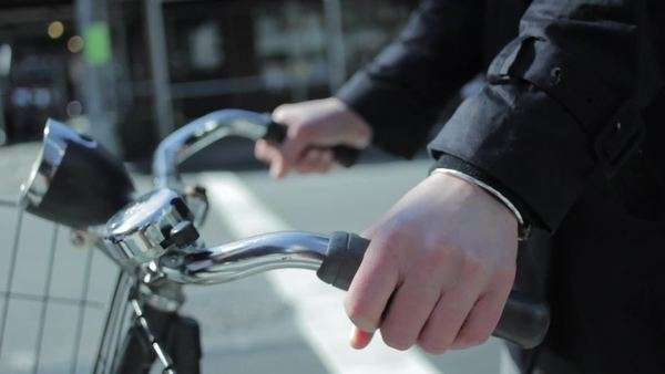 Static shot of a man's hands firmly holding the handlebar grip of a bicycle Royalty-free stock video