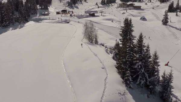 Aerial shot of people skiing in a french ski resort in the Alps Royalty-free stock video