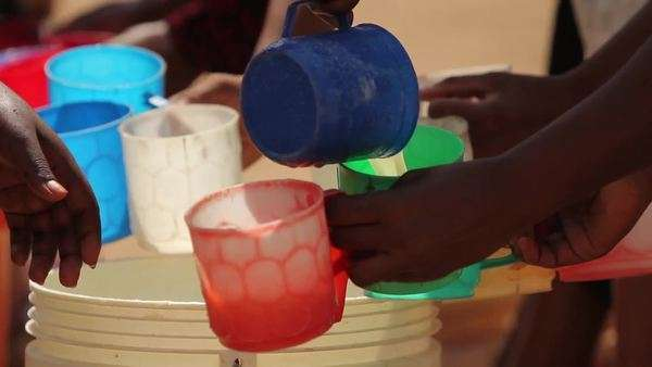 African drink being distributed for pupils in class Royalty-free stock video