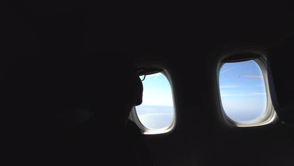 Hand-held shot of a woman sitting on a plane Royalty-free stock video