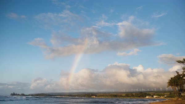 Hand-held shot of a rainbow above a shore Royalty-free stock video