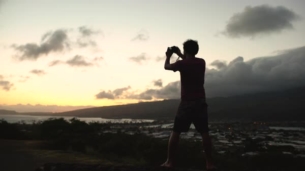 Hand-held shot of a man making a video at sunset Royalty-free stock video