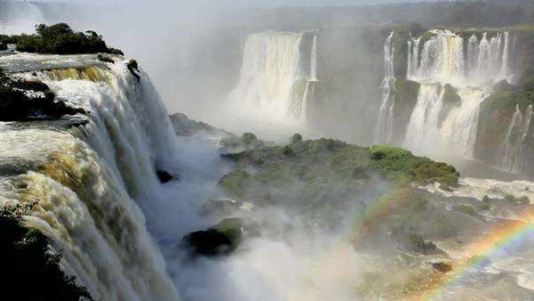 Landscape view of rainbow created from the Iguacu Falls, Foz Do Iguacu, Brazil, South America Royalty-free stock video