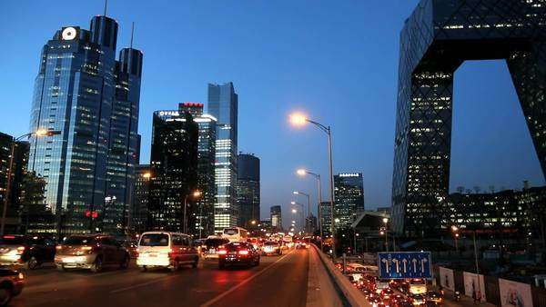 China - October 2013: Illuminated view CCTV building Beijing Central Business district dusk commuter city traffic skyline, China, Royalty-free stock video