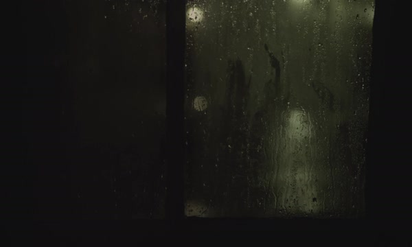 Stormy rain outside dark window at night Royalty-free stock video