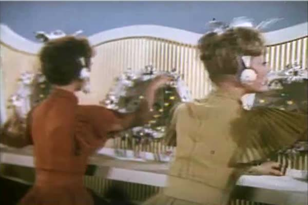 A group of telephone operators sings and dances about how life depends on the telephone in 1960. Royalty-free stock video
