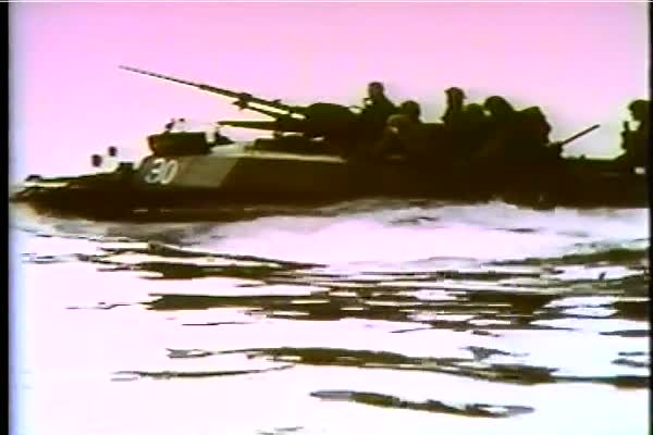 Allied troops cross the Rhine River with amphibious vehicles in the spring of 1945 in WWII. Royalty-free stock video