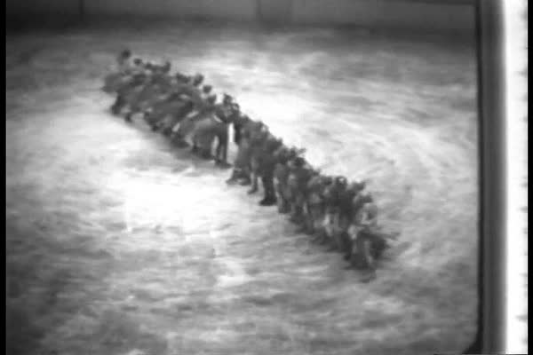 Synchronized ice skaters are followed by a solo performer in 1934. Royalty-free stock video