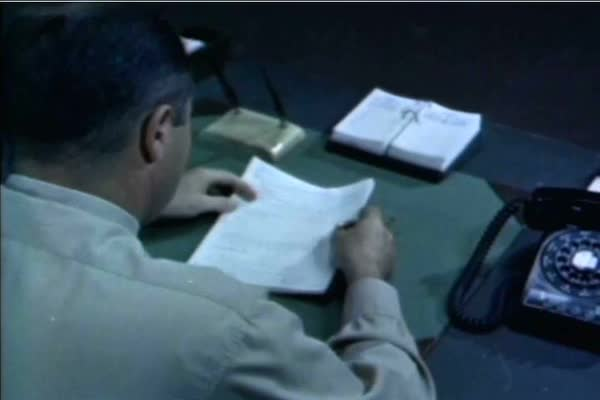 After writing an unsatisfactory flight report, a student at the US Naval Test Pilot School is shown either rewriting his report, or flying the aircraft again in 1959. Royalty-free stock video
