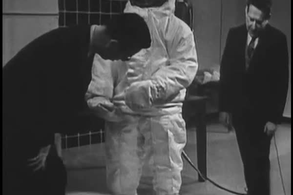 A quick look at how astronauts footwear protected them from temperatures ranging from boiling to 200 below zero, as well as how their sun visors shield from blinding sunlight and burning radiation in the 1960s. Royalty-free stock video