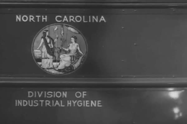 A National Institute of Health bus is used as a field laboratory, African American workers are x-rayed, a riveter works and soldiers cross a river in tanks, in 1943. Royalty-free stock video