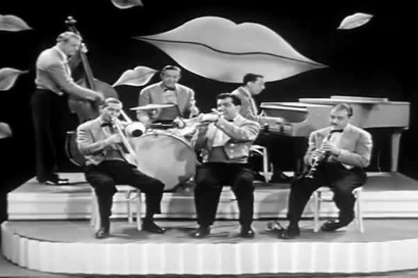 An all female orchestra plays swing jazz music in this 1940s soundie