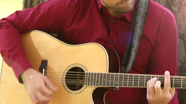 Close-up view of man playing acoustic guitar Royalty-free stock video