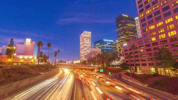 DOWNTOWN, LOS ANGELES, CALIFORNIA, USA - 30 SEPTEMBER 2014, Hyperlapse video view on sunset over buildings and freeway traffic. Transition from day to night. Royalty-free stock video