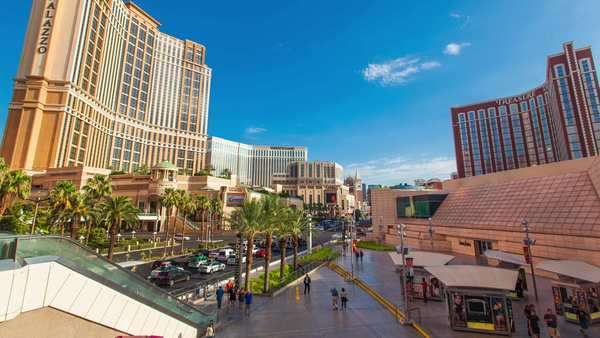 LAS VEGAS, NEVADA - JULY 10, 2014. Timelapse in motion (Hyperlapse) video view on Las Vegas Strip from Fashion Square Mall. Sunny day. Moving people, clouds, traffic. View on PALAZZO and TREASURE Royalty-free stock video