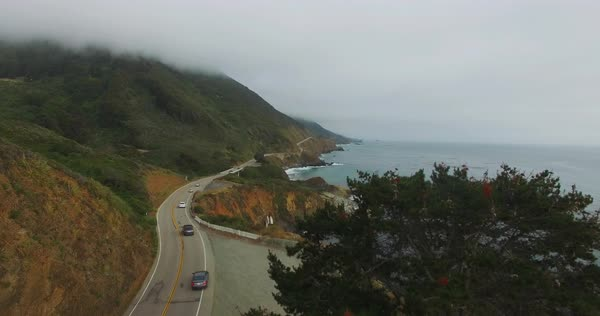 Aerial shot of cars on a road at Big Sur, California, USA Royalty-free stock video