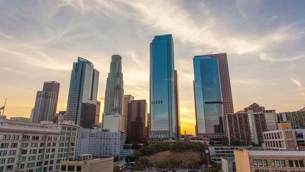 DOWNTOWN, LOS ANGELES, CALIFORNIA, USA - 11 SEPTEMBER 2014, Sunset in the big city. Timelapse on skyscrapers at dusk. Royalty-free stock video